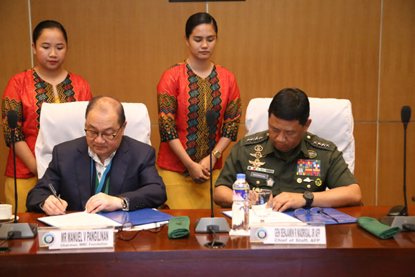 AFP Chief of Staff General Benjamin Madrigal Jr and MMCF Chairman Manny Pangilinan signed the MOA aimed to strengthen the capabilities of military hospitals and treatment facilities nationwide / Photo Courtesy AFP