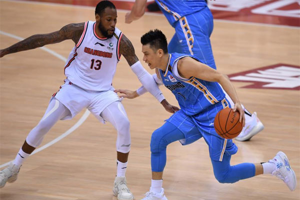 eremy Lin (right) of Beijing Ducks breaks through the defense of Sonny Weems of Guangdong Southern Tigers during the semifinal of the 2019-2020 Chinese Basketball Association (CBA) league in Qingdao, east China's Shandong Province on Aug. 8, 2020. Lin said on Tuesday (Sept. 15) he will not play in the 2020-21 CBA season because of his dream to play anew in the NBA. (Xinhua/Li Ziheng)