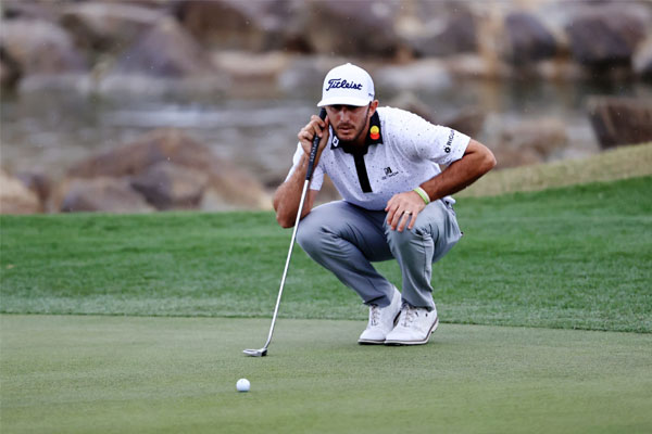 Max Homa lines up a putt on the 18th hole during the third round of The American Express tournament on the Stadium course at PGA West on January 23, 2021 in La Quinta, California. Sean M. Haffey/Getty Images/AFP