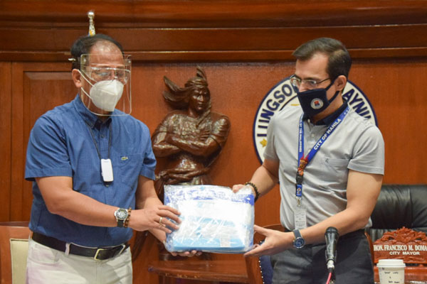 National Task Force on Covid-19 chief implementer, Secretary Carlito Galvez Jr., turns over to Manila Mayor Francisco Isko Moreno Domagoso some 10,000 personal protective equipment as he commended the city of Manila in its efforts to fight the pandemic / Photo Courtesy of Mayor Isko Moreno / Facebook