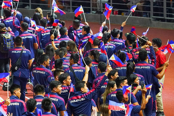Filipino athletes march during the SEA Games closing ceremonies at the athletics stadium in Clark / Photo Courtesy of ABS-CBN News