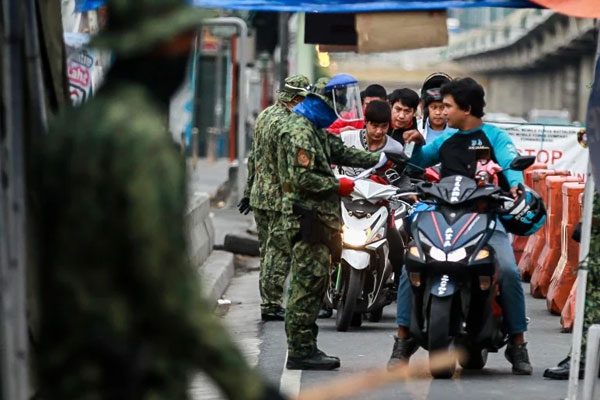 Motorcycle checkpoint near Marikina-Antipolo boundary / Photo Courtesy of Xinhua
