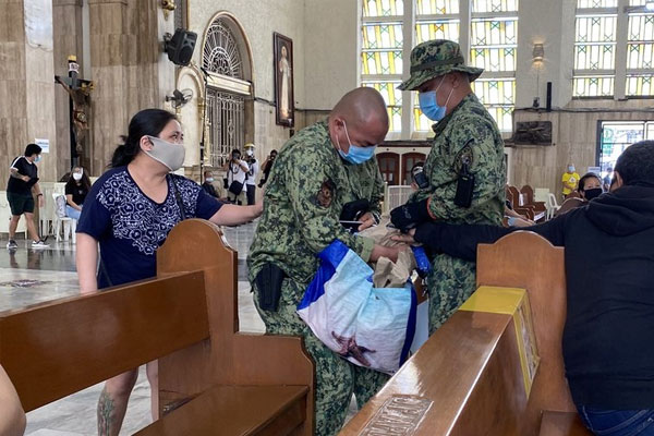 Manila police confiscated Anti-Terror Law protest materials from some Akbayan members who were attending Mass inside Quiapo Church on Monday, July 27 / Rappler