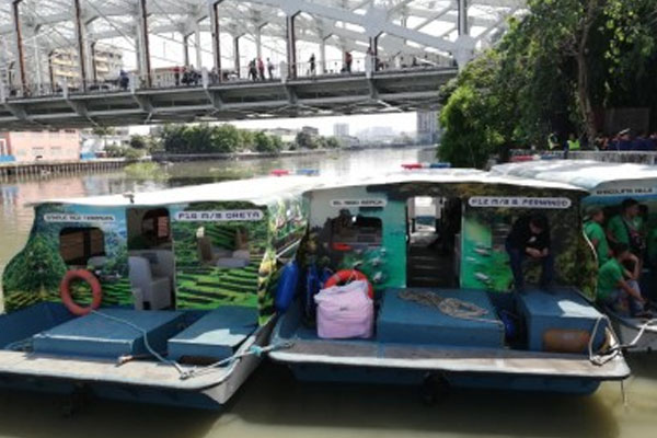 Ferry boats docked in one of the stations of the Pasig River Ferry Service. Partial resumption of the operations will start on Monday, with passengers getting free rides / PNA