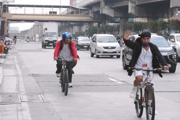 Bicycle riders ply through the outermost portion of the Edsa Cubao southbound lane in Quezon City on Tuesday (May 26, 2020) / PNA