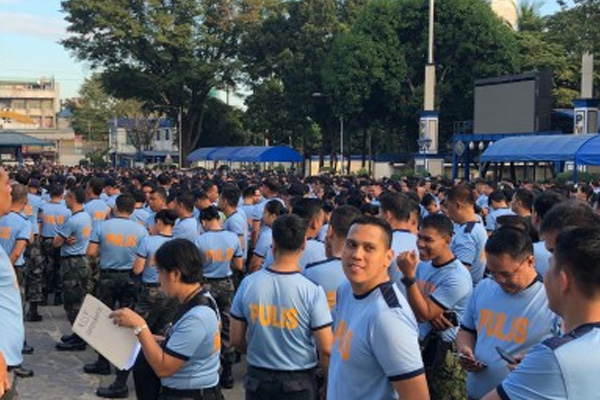 Police officers belonging to the Reactionary Standby Support Force (RSSF) hold a formation in a send-off ceremony at Camp Crame, Quezon City on Friday / PNA