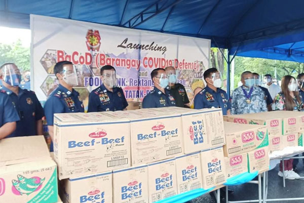 PNP officials led by Gen. Camilo Cascolan (3rd from left) lead the launching of the Barangay Covid Defense (BaCoD) and the PNP Food Bank in Camp Crame on Friday (Sept. 11, 2020) / PNP PIO  / PNA