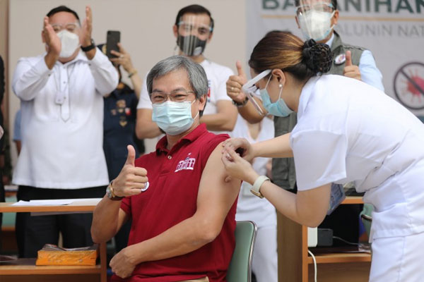 Philippine General Hospital Director, Dr. Gerardo Legaspi, gets the first inoculation of the CoronaVac donated by China shortly after 9 a.m. on Monday (March 1, 2021) at Philippine General Hospital in Manila City, opening a new chapter in the battle against the coronavirus disease 2019 (Covid-19) / PNA