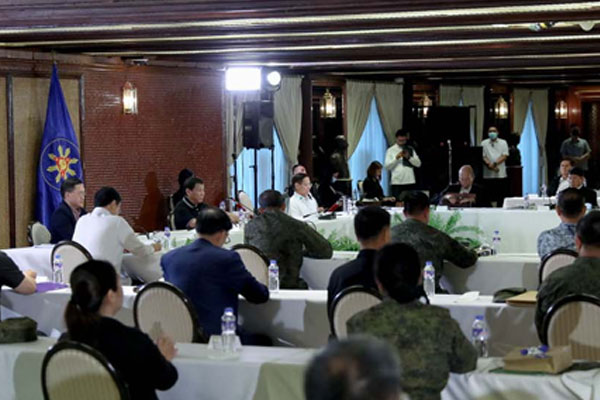 President Rodrigo Duterte convenes with the officials of the Inter-Agency Task Force for the Management of Emerging Infectious Diseases at the Malaca%uFFFDan Palace on March 16, 2020 / PNA
