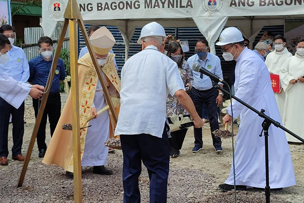 Manila Archbishop Jose Cardinal Advincula (left, in gold vestment) leads the groundbreaking of Sto. Ni%uFFFDo Parish in Pandacan, Manila on Saturday (July 10, 2021). The church was gutted by a fire last year. (Photo from Sto Nino Parish Pandacan Facebook page)