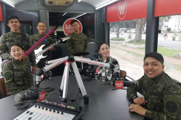 The CRS-AFP band, the official band of the Armed Forces of the Philippines (AFP), sings three of its original compositions at the Wish Bus 107.5. The group sang stories of soldiers at work and love for the country / PNA / Christine Cudis