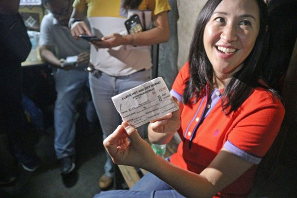 Mayor Joy Belmonte is holding a receipt given by a firm that reportedly collects daily fees from the vendors. / PhilStar