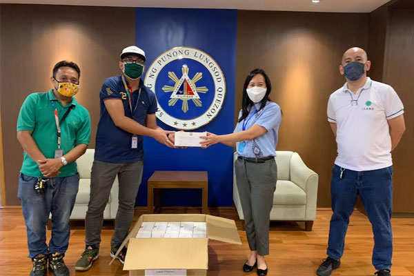 ISOC Holdings Inc. donates Rapid Test Kits to the Quezon City Government to help in their efforts of flattening the curve. Quezon City Mayor Joy Belmonte receive the SARS-Cov-2 Ab Rapid Test Kits from Mr. Robbie Barredo, ISOC Holdings Permits Assistant, Mr. Sonny Daugdaug of ISOC Holdings, and Mr. Paul Anthony Isla, ISOC Holdings Corporate Affairs Manager (fourth from left). / MNC Photo File