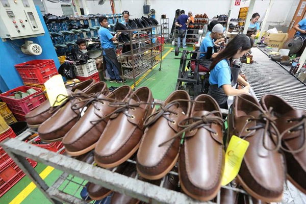 Pairs of high-quality shoes made in Marikina City are shown to members of the media during a tour of C Point Manufacturing%u2019s shoe factory in Barangay Concepcion Uno on Aug. 7, 2019. Photo by Boy Santos, The Philippine STAR