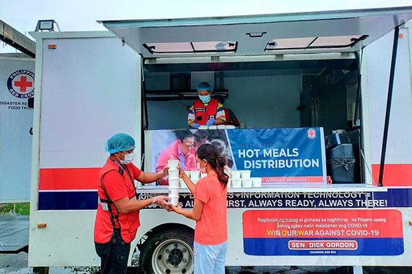 Philippine Red Cross food truck distributes hot meals to Sta.Ana Cagayan affected by Typhoon Kiko. (Photo courtesy of PRC)