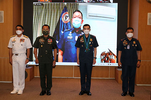 Officials of the Armed Forces of the Philippines (AFP), Philippine National Police (PNP) and the Philippine Coast Guard (PCG) pose for a photo opportunity on the sidelines of the signing of a tripartite mechanism in Camp Aguinaldo, Quezon City on Friday (July 23, 2021) / Photo Courtesy of PNP