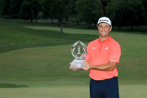 Jon Rahm of Spain celebrates with the trophy after winning during the final round of The Memorial Tournament on July 19, 2020 at Muirfield Village Golf Club in Dublin, Ohio. Photo by Sam Greenwood/Getty Images