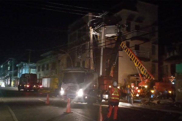 Meralco and First Catanduanes Electric Cooperative crews work arm-in-arm around the clock to repair severely damaged poles and fast-track power restoration efforts in Catanduanes, one of the provinces most severely affected by the impact of super typhoon Rolly.