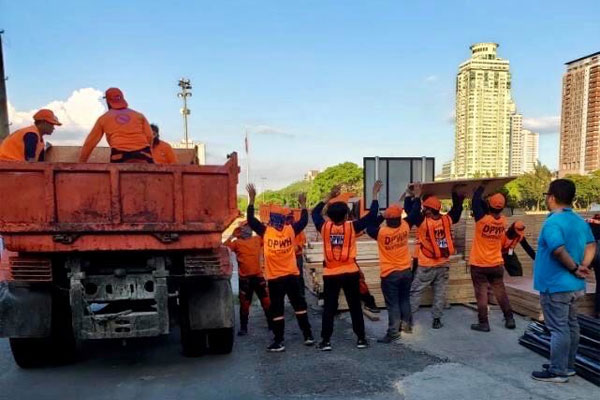 Workers of the Department of Public Works and Highways unload materials for the conversion of the Philippine International Convention Center (PICC) Forum Halls into a temporary facility for Covid-19 patients on Thursday (April 2, 2020) / DPWH