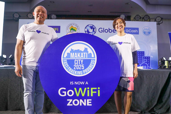 Makati Mayor Abby Binay and Globe Telecom President and CEO Ernest Cu press the button to activate the Makatizen GoWiFi
