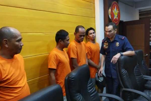 NCRPO chief, Maj. Gen. Guillermo Eleazar talks to four GCTA-freed convicts who surrendered to authorities in Camp Bagong Diwa, Taguig City on Thursday
