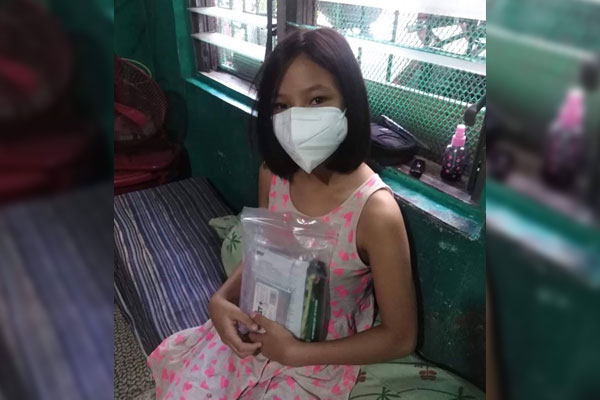 Makati Student with her city provided emergency go-bag containing N95 Face Mask / Makati PIO