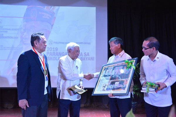 Delfin J. Wenceslao, Jr., a distinguished PVAO Scholar and Director and Chairman of the Board, D.M Wenceslao & Associates, Inc. receives his plaque of Recognition at the 2019 PVAO Scholar