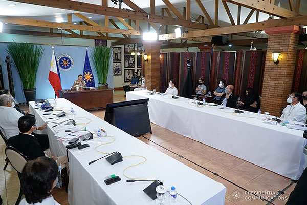 President Rodrigo Roa Duterte presides over a meeting with the Inter-Agency Task Force on the Emerging Infectious Diseases (IATF-EID) core members prior to his talk to the people at the Malaca%uFFFDang Golf (Malago) Clubhouse in Malaca%uFFFDang Park, Manila on April 28, 2021. / PCOO