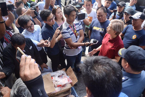 Vice Mayor Honey Lacuna on Monday inspected more than 20 tons of imported contraband meat from China seized by authorities in Tondo / Manila PIO
