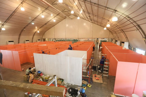 Personnel from the Department of Public Works and Highways rush to construct facilities for coronavirus disease 2019 (Covid-19) cases at the Philippine International Convention Center (PICC) on Monday (April 6, 2020) / PNA