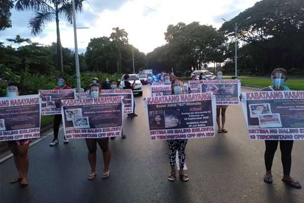 Anti-communist groups stage a protest rally in UP Diliman on Thursday to denounce the violence and abuses committed by the Communist Party of the Philippines-New Peoples Army-National Democratic Front (CPP-NPA-NDF) / PNA