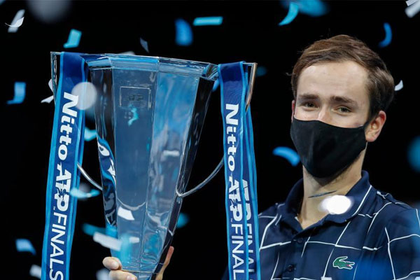 Daniil Medvedev of Russia poses with his trophy during the awarding ceremony for the singles final against Dominic Thiem of Austria at the ATP World Tour Finals 2020 in London, Britain on Nov. 22, 2020. It was Medvedev%u2019s first ATP Finals victory. (Xinhua/Han Yan)